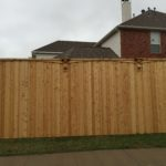 This is a picture of a decorative cedar fence being built.